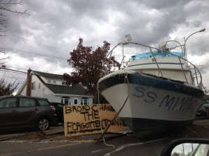 A boat lies in the middle of the road in Broad Channel